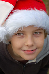 Christmas Blake (Odelay79) Tags: christmas holiday beautiful hat d50 50mm kid nikon braces handsome son stunning blake merrychristmas santahat christmashat fuzzyhat chappedlips niftyfifty aplusphoto platinumheartaward