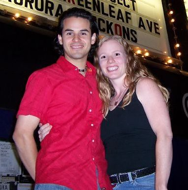 Sol and Monica in Front of a Marquee After a Gig