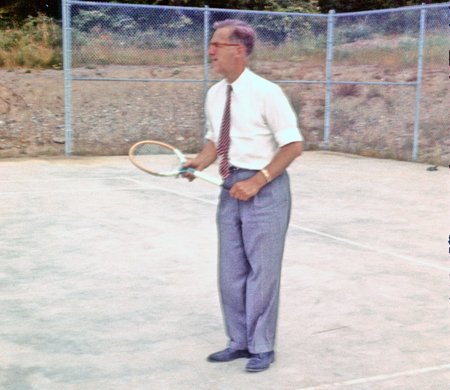 papa playing tennis in work clothes