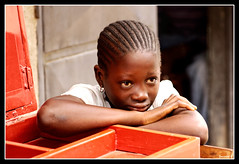 La petite  la boite rouge (Laurent.Rappa) Tags: voyage africa unicef travel portrait people face children child retrato laurentr enfant ritratti ritratto regard ctedivoire peuple afrique ivorycoast mywinners ivorycost anawesomeshot laurentrappa