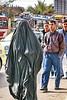 Back in Black (hazy jenius) Tags: world street city trip travel people urban woman black shopping veil market muslim islam headscarf hijab strangers photojournalism backpack cannon modesty bazaar niqab souq global euphrates burka chador deirezzur hejab deirezzor alfurat dayrazzaur