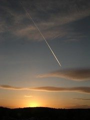 plane slices through sunset (pastamaster39) Tags: sunset sky clouds plane scotland cut glasgow peaceful silouette line whiteline shawlands pollockcountrypark