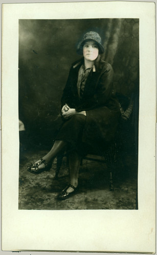 woman seated tinted RPPC