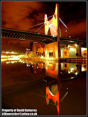 Bilbao Bridge of Dream City Red Color Lights at Night (david gutierrez [ www.davidgutierrez.co.uk ]) Tags: city bridge light red sky urban brown color reflection building green nature yellow architecture night clouds buildings river dark spectacular geotagged photography lights mirror photo spain arquitectura europe cityscape darkness image dusk earth centre dream shapes cities cityscapes bridges center structure architectural bilbao espana nighttime finepix architektur nights fujifilm sensational guggenheim metropolis rays topf100 bizkaia impressive basquecountry nightfall municipality edifice cites 100faves s6500fd s6000fd platinumphoto puentedelasalve fujifilmfinepixs6500fd platinumheartaward theperfectphotographer lasalvebridge colorsandmagic dreamcityredcolorlights