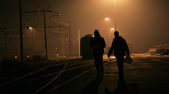 Coming from the fog (ozio-bao) Tags: silhouette fog yard train persone treno railroads binari challengeyouwinner oziobao