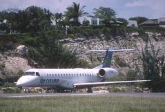 227aa  - Air Caraibes Embraer ERJ145MP; F-OIJE@SXM;21.04.2003 (Aero Icarus) Tags: slidescan plane avion aircraft flugzeug princessjulianainternationalairport saintmartin