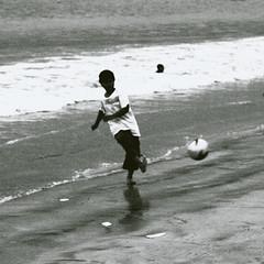 P6060352-14 (25 minutes) Tags: ocean life street leica sea bw bali white black nature indonesia lumix football goal asia f14 snap east omd 25mm streetsnap em5 omdem5