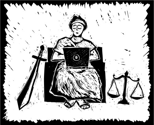 lady justice with laptop