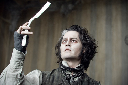 'At last, my arm is complete again!' Johnny Depp is a cutup in 'Sweeney Todd: The Demon Barber of Fleet Street'.