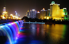 May your 2008 be full of colors (Life in AsiaNZ) Tags: china city longexposure bridge urban lake color water fountain colors night canon buildings lights hotel rainbow bravo asia nightshot bright g south chinese powershot southern international fv10 series   wharton afterdark nanning  guangxi dusktilldawn nanhu    g9   gseries  aplusphoto firsttheearth colourartaward colorartaward vividmasters artlegacy canong9 lifeinnanning  flickrgiants