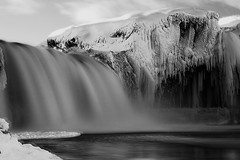 The Ghost at Godafoss (Andri Elfarsson) Tags: pictures desktop camera trip travel winter wallpaper vacation sky blackandwhite bw white holiday snow black art texture ice nature water rock closeup canon dark landscape island mono frozen iceland high rocks exposure photographer darkness photos desk quality fineart ghost north fine large freezing tranquility frosty monochromatic full size waterfalls resolution fullresolution northern wintersnow foss icelandic vatn holyday godafoss andri frozenice winterfrost freedesktop freewallpaper anawesomeshot landscapephotographer diamondclassphotographer betterthangood elfarsson andrielfarsson wallpaperbw waterfallsofthegods ljosmynd desktopbw desktopblackandwhite wallpaperblackandwhite