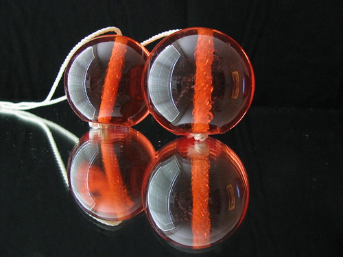 red orange toy clackers