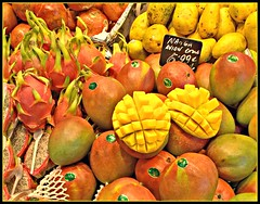 Mangos (Andrew E. Larsen) Tags: barcelona red orange reflection frutas yellow fruit religious juicy spain worship europe market best mercado mango reflective catalunya presentation digitalrebelxt powerpoint boqueria contemplation vegetales biblicalthemes papalars a3b andrewelarsen