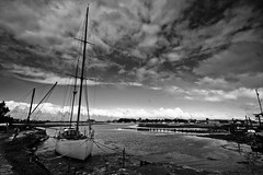 River Yar, Yarmouth, Isle of Wight (s0ulsurfing) Tags: light shadow sky blackandwhite bw cloud sunlight white black weather silhouette clouds contrast wow river island grey mono boat interesting dock skies bright wind yacht pov patterns wide perspective silhouettes dramatic wideangle monotone rope explore pointofview coastal filter vectis isleofwight cumulus mast ropes yarmouth docked grad drama 2008 isle tidal atmospheric rigging wight yar altocumulus westwight 10mm themoulinrouge sigma1020 nd4 s0ulsurfing riveryar aplusphoto infinestyle diamondclassphotographer flickrdiamond vision100