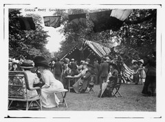 Garden Party, Governor's Island  (LOC) (The Library of Congress) Tags: new york old city nyc newyorkcity party usa history glass america vintage island harbor costume women dress lawn patriotic flags tent negative parasol libraryofcongress 1910s wicker governorsisland gardenparty 1911 governors socialevent oldtimey bunting 5x7 historicalphoto glassnegatives georgegranthambaincollection 19101915 xmlns:dc=httppurlorgdcelements11 henrylstimson dc:identifier=httphdllocgovlocpnpggbain09245 bainnewsservice generalfrederickdentgrant may251911 armyreliefsocietylawnparty