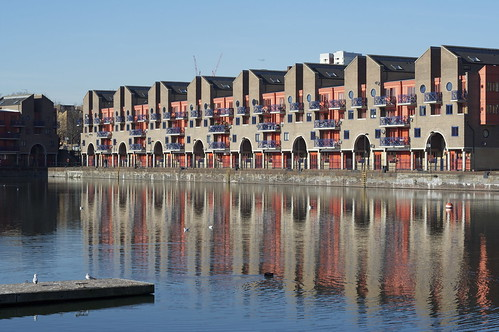 apartments reflected in water