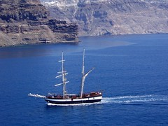Arriving at Santorini (saxonfenken) Tags: blue cliff island boat wake yacht aegean