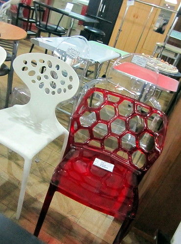 clear chairs from woman