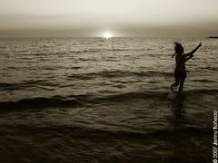 (dbqueen) Tags: friends sunset people beach monochrome silhouette dance waves philippines explore 2007 zambales elsol bwdreams superhearts whitesandbeachresort jennytañedo