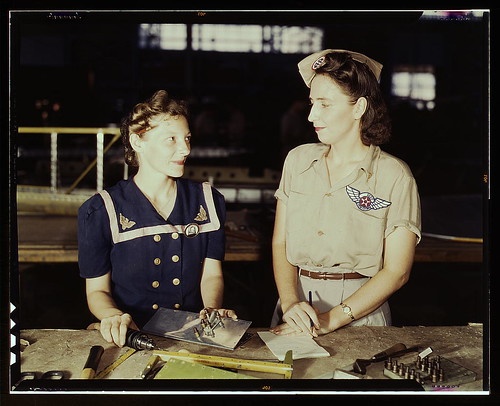 Pearl Harbor widows have gone into war work to carry on the fight with a personal vengeance, Corpus Christi, Texas. Mrs. Virginia Young (right) whose husband was one of the first casualties of World War II, is a supervisor in the Assembly and Repairs Depa by The Library of Congress.