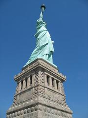 The Statue of Liberty (lee_yoshida) Tags: city newyorkcity trip travel vacation usa newyork canon statueofliberty nationalparkservice nationalmonument libertyisland  bartholdi   statuedelalibert libertyenlighteningtheworld  alexandregustaveeiffel symboloffreedom frdricaugustebartholdi lalibertclairantlemonde   eugneviolletleduc  libertyislandstatueoflibertymanhattannewyork                 october281886 douardrendelaboulaye uspatentd11023