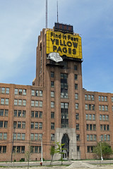 Abandoned Michigan Bell Building - Highland Park (DetroitDerek Photography ( ALL RIGHTS RESERVED )) Tags: abandoned sign june yellow cool closed neon apartments phone bell decay empty telephone urbandecay homeless ad detroit may advertisement vacant highlandpark 2008 economy renovate yellowpages reuse 313 motown motorcity michiganbell oakman focushope brownsfield letyourfingersdothewalking