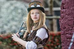 Steampunk Girl (etsie74) Tags: steampunk cutie hat gun sunglasses wall details blond model little pose canon 135mm