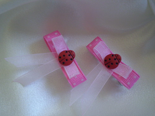 Pink Hair Bow. Mini Pink Hair Bow Set with ladybugs attached to 1 inch french clips. Made from one pink polks dot and one organza ribbons. These adorable ows are perfect