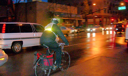 Cyclist riding with reflective safety vest