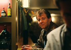 Glimpse... (Trapac) Tags: uk england man film beer bar bristol spring firefox pub nikon sitting fuji superia watching flickrr nikkor50mmf18 flickrmeet nikonf80 fujisuperia 800iso wmh colstonyard flickr:user=firefox