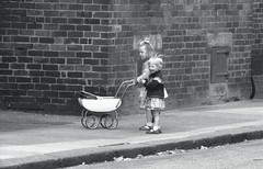 There may be trouble ahead ... (Reciprocity) Tags: street uk girls bw film 35mm play negative 1960s ilford pram concern barrowinfurness reciprocity hp3