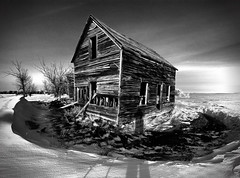 A Mere Shadow of Oneself (Ernie Fischhofer (off & on w/ hockey season!)) Tags: old house snow canada cold farmhouse photography blackwhite ruins shadows antique farm alberta weathered thehouse differentvisions artedellafoto erniefischhofer dragondaggerphoto