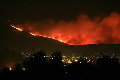 Mt. San Miguel on fire.  San Diego wildfire as seen looking south from my backyard in Santee. (slworking2) Tags: california county mountain miguel fire spring san mt flames diego east flame burn valley harris fuego 2007 wildfire firestorm golddragon onlythebestare harrisfire mtsanmiguel