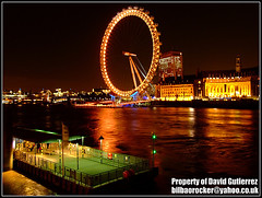 London Eye Red Colors (davidgutierrez.co.uk) Tags: road county city uk greatbritain travel bridge blue red england sky urban orange color reflection green london eye tourism colors westminster fashion wheel yellow thames modern pier hall education media europe diverse unitedkingdom britain south politics capital great culture cityscapes bank londoneye millenium landmark icon entertainment hungerford finepix historical fujifilm multicultural riverthames metropolitan touristattraction attraction countyhall cityoflondon waterloobridge squaremile cityofwestminster redcolor s6500fd 6000v240f s6000fd worldicon londonred londoncolors londoncolour muncipality londoncolor londoncolours flickr:user=davidgutierrez2007