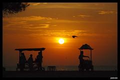 Timepass (peevee@ds) Tags: sunset orange sun beach colors standing evening waiting sitting time pass mangalore sellers ullal vendors fpc perumal venkatesan venkatesanperumal bpcprofile