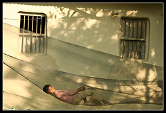 Destination [..Chuadanga, Bangladesh..] (Catch the dream) Tags: windows boy shadow portrait sun sunlight net home window smile rural bed ray village child bongo stretch relaxation bengal bangla bengali bangladeshi bangali hamok catchthedream gettyimagesbangladeshq2