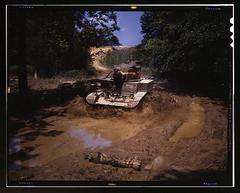 Light tank going through water obstacle, Ft. Knox, Ky.  (LOC) (The Library of Congress) Tags: reflection water june training army war tank mud fort kentucky military wwii stuart worldwarii armor ww2 libraryofcongress 1942 m3 obstacle fortknox worldwar2 usarmy wartime m3a1 m3stuart xmlns:dc=httppurlorgdcelements11 stuarttank dc:identifier=httphdllocgovlocpnpfsac1a35194 alfredtpalmer june1942 alfredpalmer fortknoxky m3stuarttank