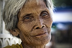 Yesterday (jeridaking) Tags: old portrait people woman church face look lines canon 350d back eyes asia southeastasia candle looking philippines memories poor filipino vendor rebelxt yesterday wrinkles ralph pinoy visayas leyte ormoc bisaya bisdak  ormocanon jeridaking matres fortheloveofphotography leytephotographer ormocphotographer