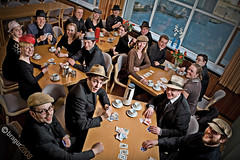 A group of musicians playing poker (bragur) Tags: musician music playing money window coffee musicians cards wizard group band hats poker cups orchestra tables chamber pocket pw canoneos5d pocketwizard strobist canonef2470mmf28usm safold kammersveitinsafold kammersveit