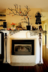 Mantle Asylum (2) (boopsie.daisy) Tags: flowers decorations tree halloween skull fireplace candles hand spiders pumpkins books livingroom ornaments frankenstein jigsaw mantle spiderwebs cobwebs dollhead snowglobe halloweentree dollparts deathscene catinthebox