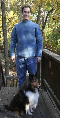 Portrait of a man, a dog, and a finished sweater