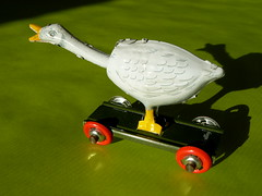 The goose that lays golden eggs. (remember moments) Tags: shadow green metal toy goose mealsonwheels goldeneggs dietmarvollmer