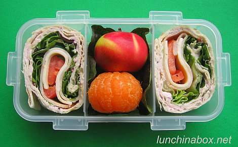 Miniature fruit & sandwich bento lunches