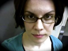 Me, at work. (astar328) Tags: selfportrait girl glasses amy atwork girlwithglasses atleastmyskinisclearforonce andimhappywithmylips aremyglassescrookedorisitjustthewaythephotoistaken godiamhot imalsocompletelykidding