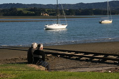 Ohiwa Harbour, Ohope (chris.bryant) Tags: sea newzealand summer sky people beach beautiful clouds landscape boats sand rust ramp couple sitting afternoon harbour tracks sit northisland yachts seated movingwater ohope bayofplentynz ohiwa ohiwaharbour flickraward aplusphotos theperfectphotographer spiritofphotography