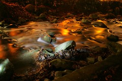 Dude, that kinda looks like Lava! (efleming) Tags: longexposure lightpainting creek river lava rocks gatlinburg strobist