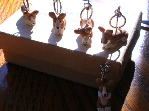 Different poses of Corgi stitch markers
