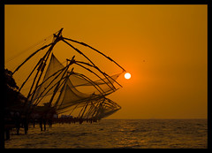 Chinese Fishing Nets In Silhouette At Sunset, Kochi, India (Eric Lafforgue) Tags: sunset red sea orange sun india fish net democracy fishermen indie nets indi cochin indien hind kochi indi inde kochin hodu southasia indland  hindistan 1846 indija   fortcochin ndia hindustan   lafforgue   ericlafforgue hindia fortkochin diamondclassphotographer flickrdiamond  bhrat  indhiya bhratavarsha bhratadesha bharatadeshamu bhrrowtbaurshow  hndkastan