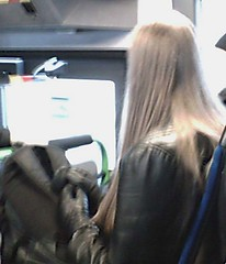 070216_155236 (RistoH) Tags: cameraphone winter black bus guy leather finland helsinki sitting candid longhair trenchcoat
