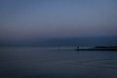 The Sweep of the Horizon (g_heyde) Tags: horizon bluehour vastness silence seaside nordsee horizont man photographer breakwater cuxhaven m9 northsea sahlenburg